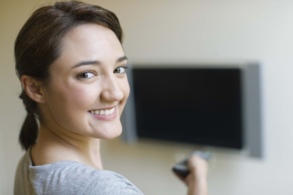 Woman turning off tv
