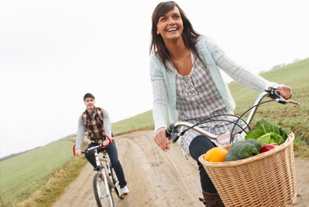 Healthy young couple biking | Sheknows.com