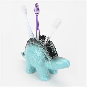 Stegosaurus toothbrush holder | Sheknows.com