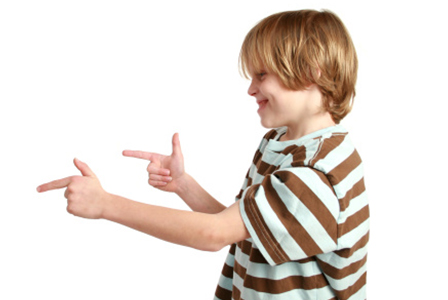 Boy with finger guns | Sheknows.com