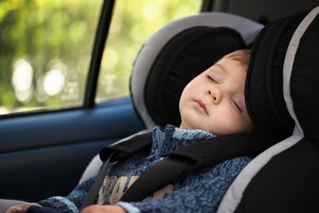 Child sleeping in car seat | Sheknows.com