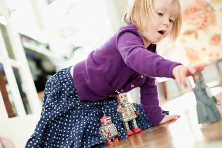 Girl playing with robots | Sheknows.com
