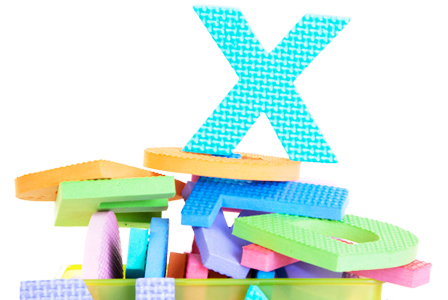Letter x on a pile of letters | Sheknows.com