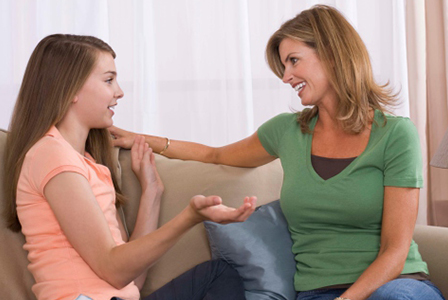 Mom and teen talking | Sheknows.com