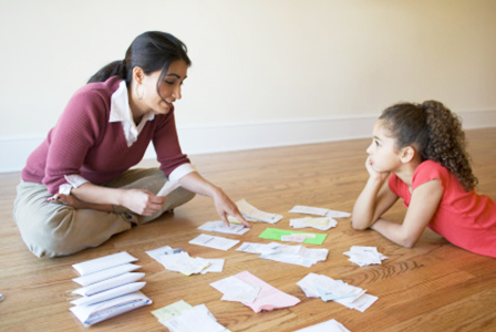 Mother working through bills with daughter   Sheknows.com