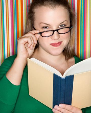 Smug woman with book | Sheknows.com