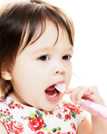 Toddler brushing teeth | PregnancyAndBaby.com