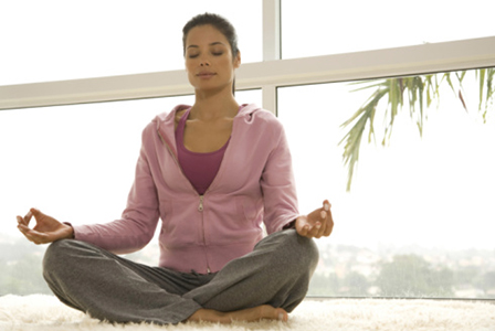 Woman meditating | Sheknows.com