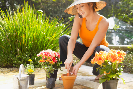 Woman planting begonias | Sheknows.com