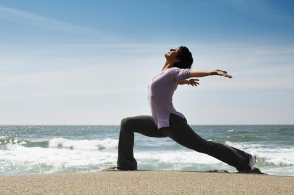 Woman practicing yoga | Sheknows.ca
