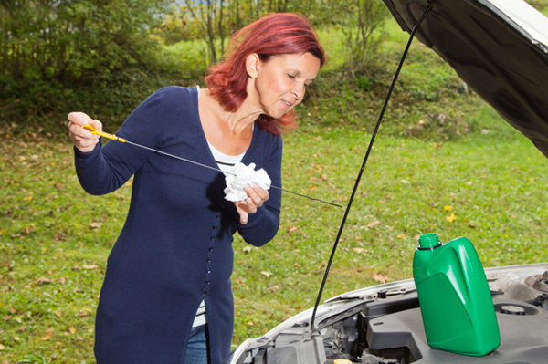 Woman working on her car | Sheknows.com