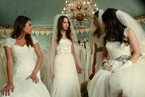 The girls search for answers in a bridal show on Pretty Little Liars