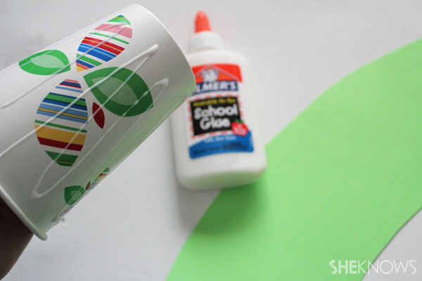 DIY Fire-breathing dragon craft: Glue paper on cup