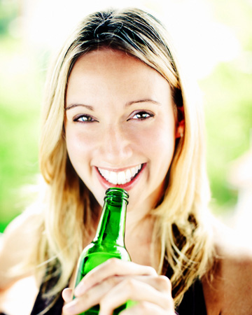 Woman drinking beer after workout