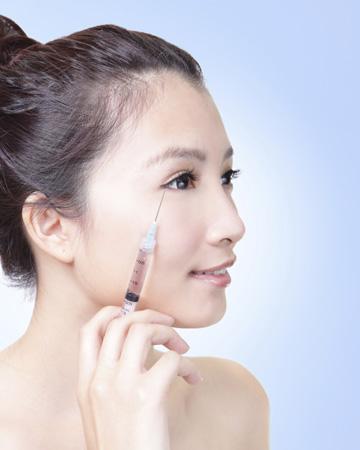 Woman injecting botox