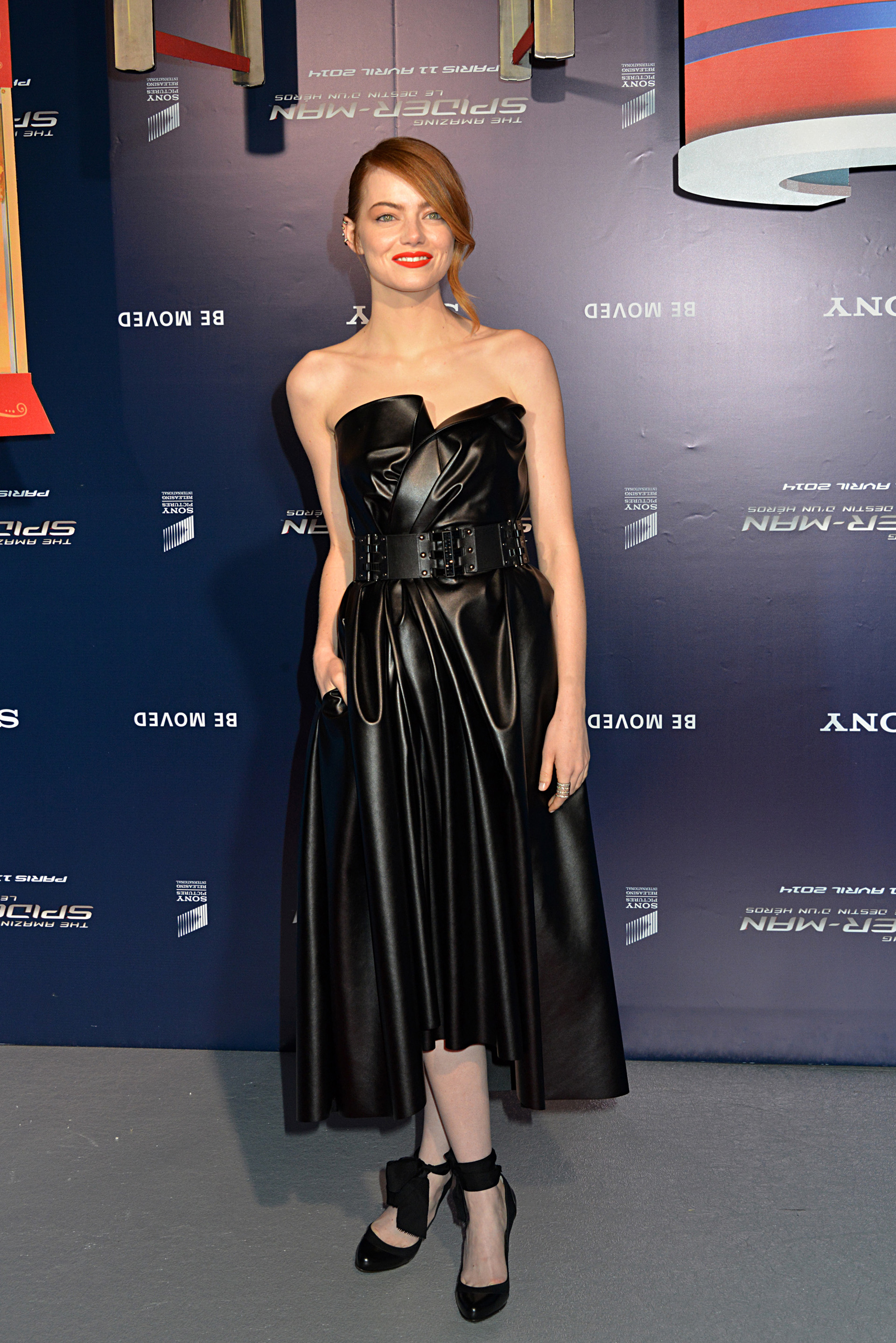 Emma Stone wearing a black leather dress