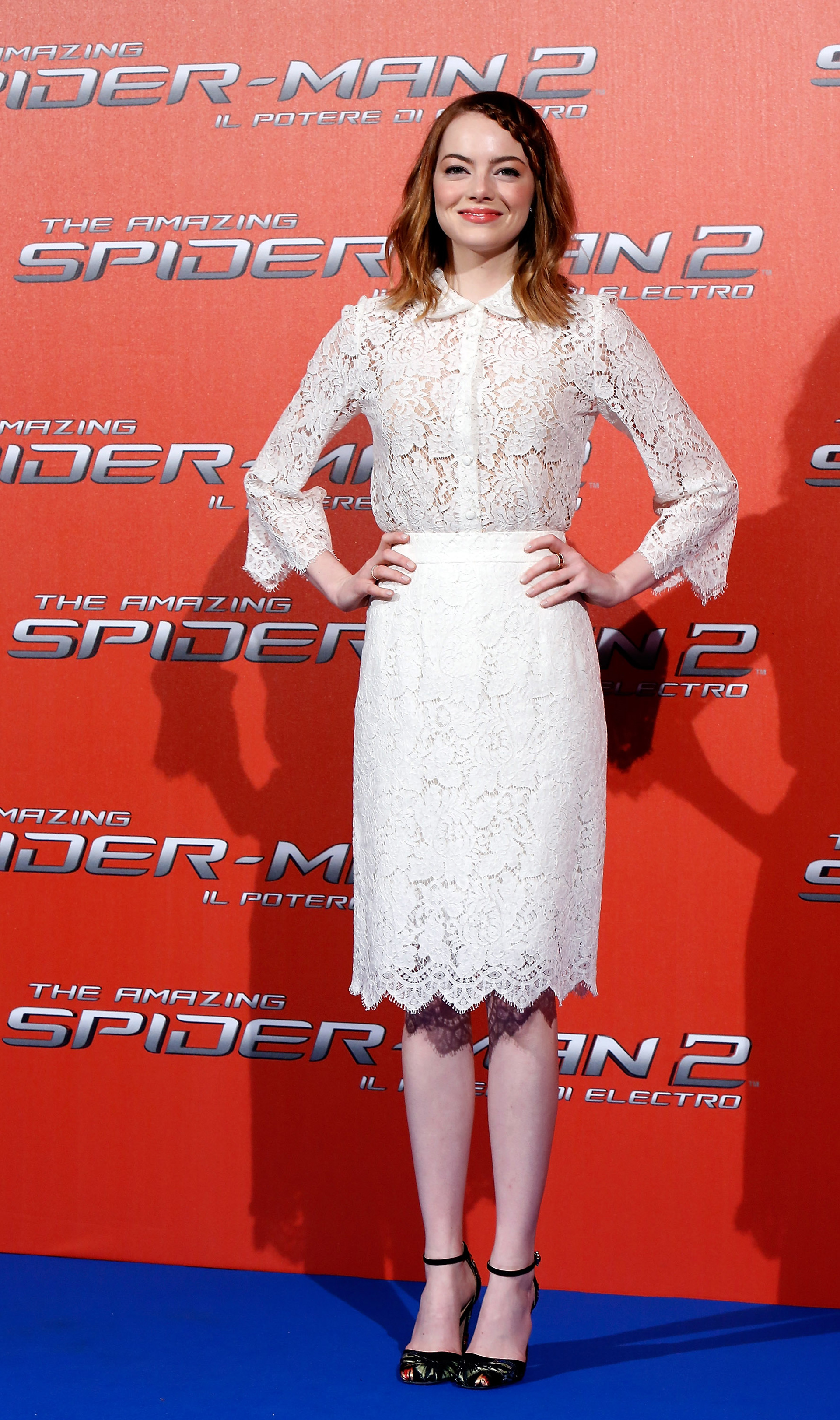 Emma Stone wearing a lace blouse and dress