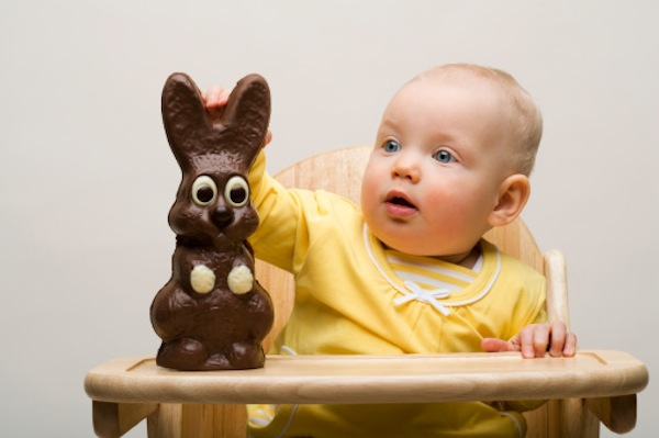 Baby about to eat a chocolate Easter bunny