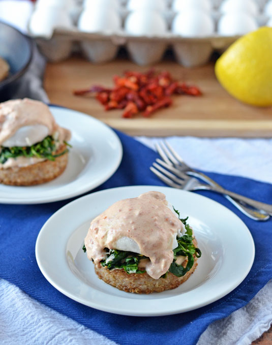 Arugula eggs Benedict with easy goat cheese Hollandaise
