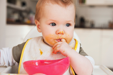 Baby with food on face | Sheknows.com