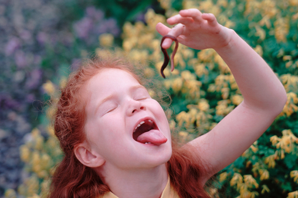 Girl eating worm | Sheknows.com