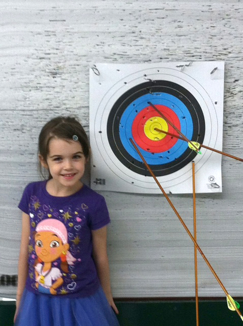 Girl learning archery | Sheknows.com