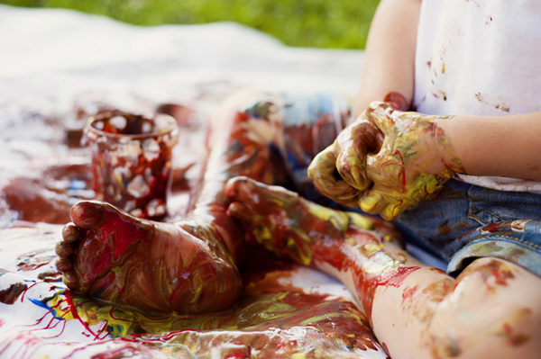Messy toddler covered in paint | Sheknows.com