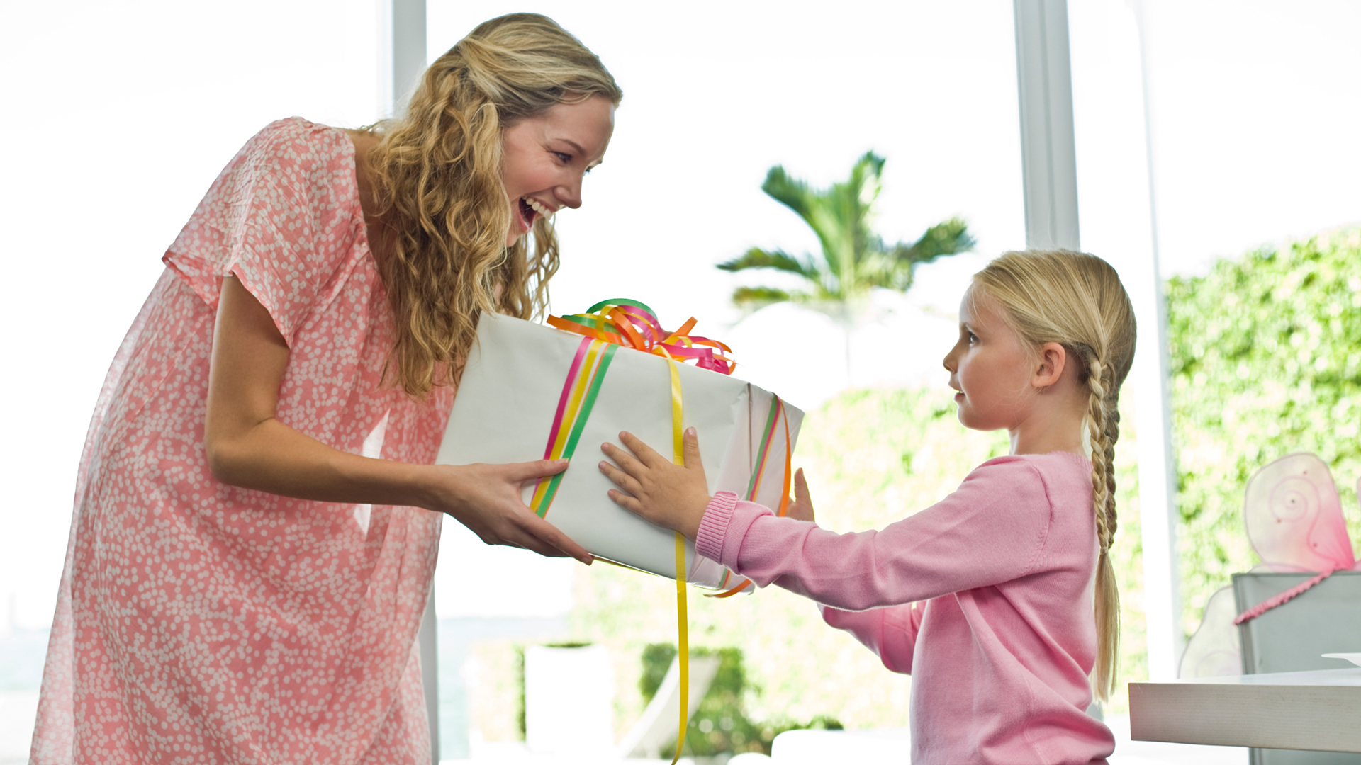 Mother getting gift from daughter | Sheknows.com