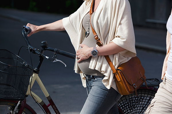 Pregnant woman with bike | PregnancyAndBaby.com