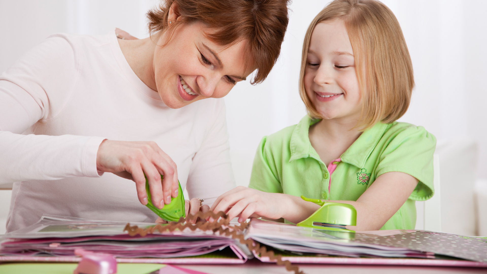 Woman scrapbooking with daughter | Sheknows.com