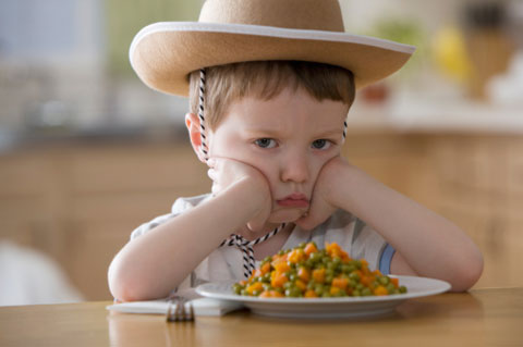 Unhappy-boy-sitting-at-dinner-table.jpg