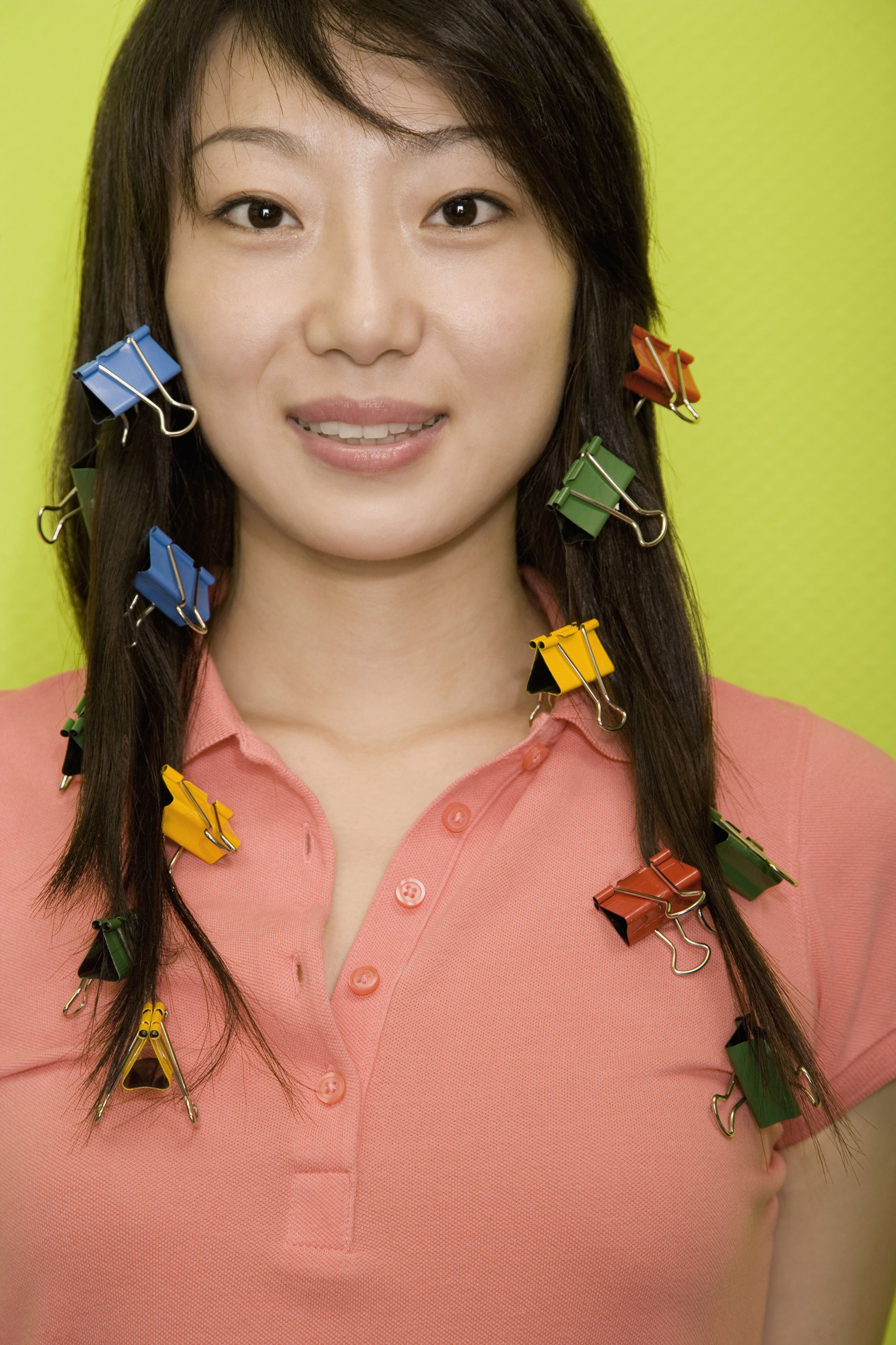Portrait of young woman with paperclips in her hair