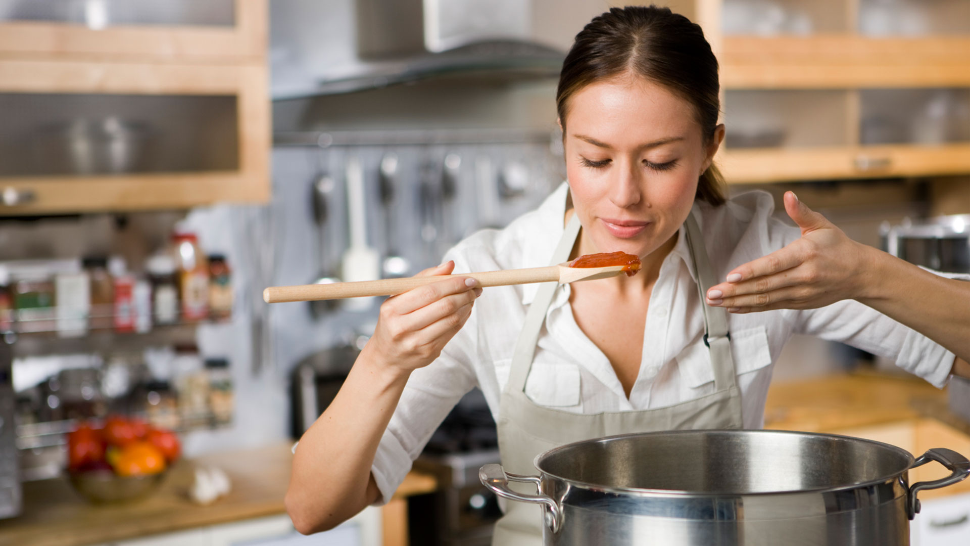 Woman cooking pasta sauce