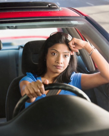 Woman driving and upset | Sheknows.com