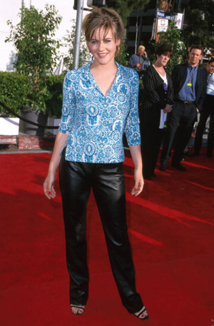 Alicia Silverstone wearing leather pants