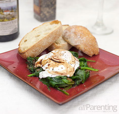 allParenting Poached eggs over a wilted spinach salad