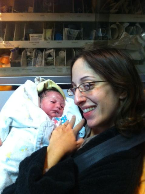 Gabby Domingues in ambulance with newborn daughter