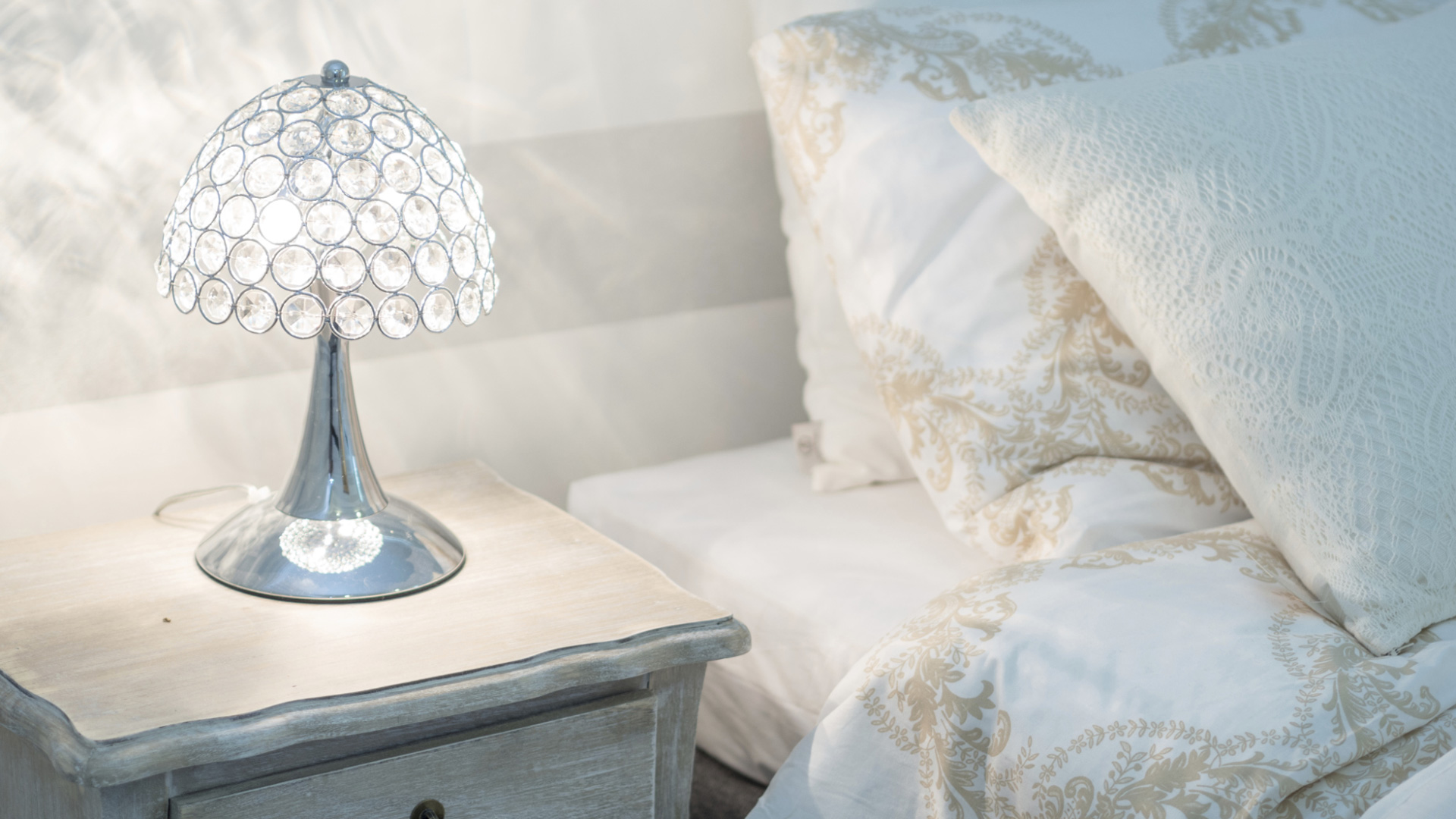 Bedroom with glass lamp