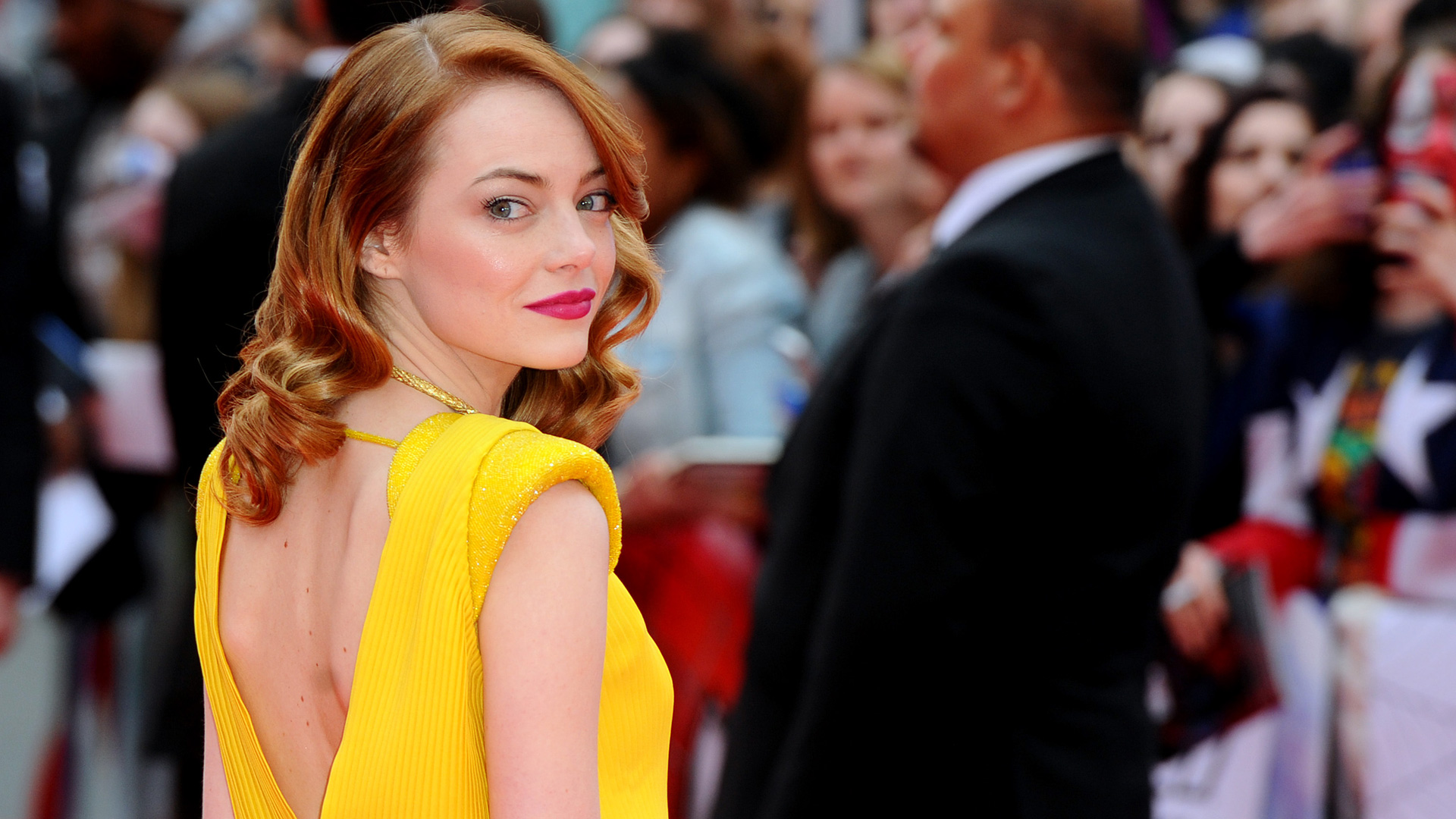 Emma Stone wearing yellow