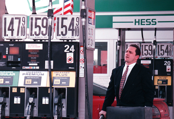 Mike Nicusanti of New York City pumps gas at a midtown Manhattan gas station, February 16, 2000.