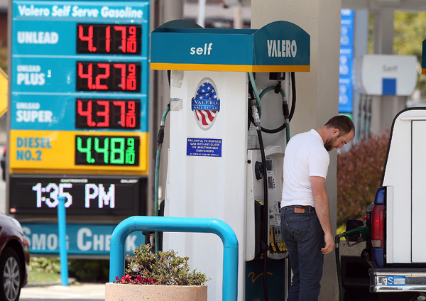 A customer pumps gas into his truck at a Valero gas station on July 22, 2013 in Mill Valley, California