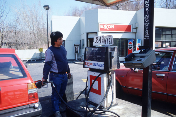 An unidentified man pumps gas at an Exxon gas station April 1986 in New Jersey.