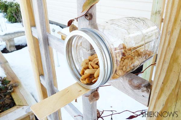 Mason jar squirrel feeder