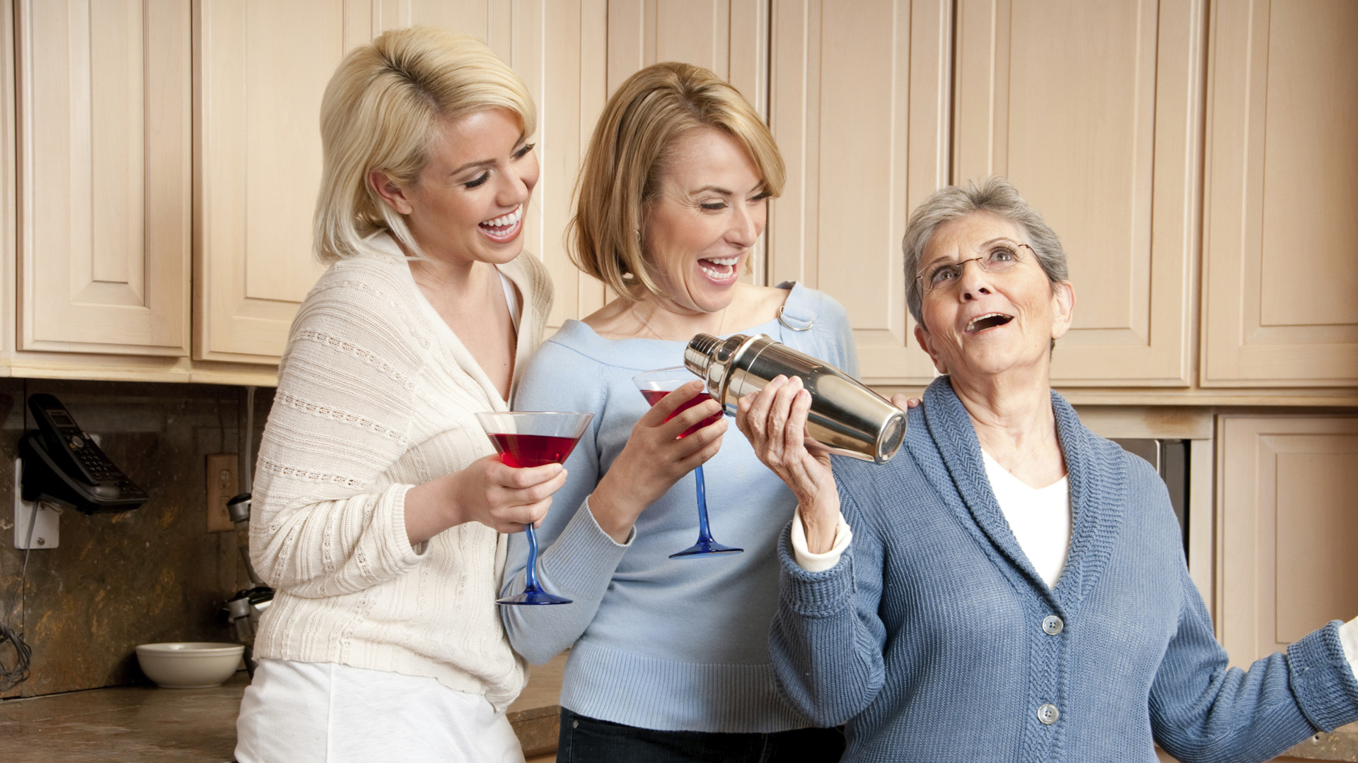Grandmother, mother and daughter making cocktails