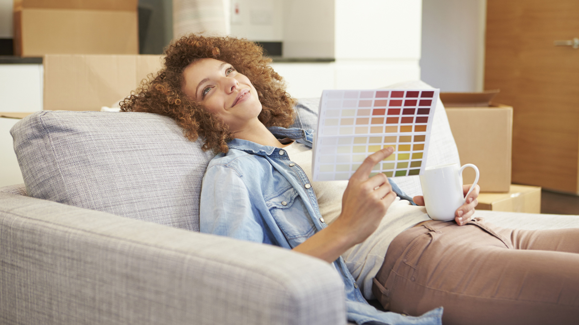 Woman looking at paint samples
