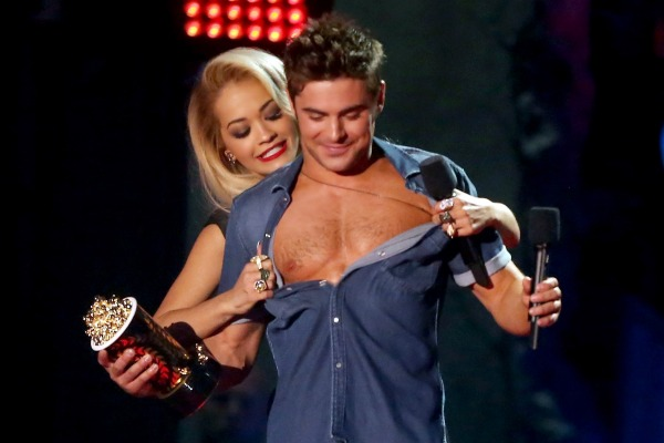 Efron strips on stage