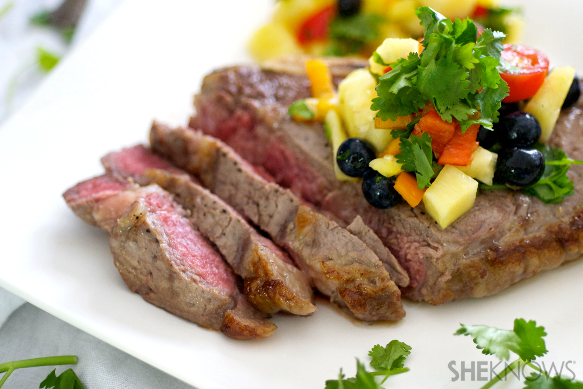 Sizzling steak with pineapple rum salsa