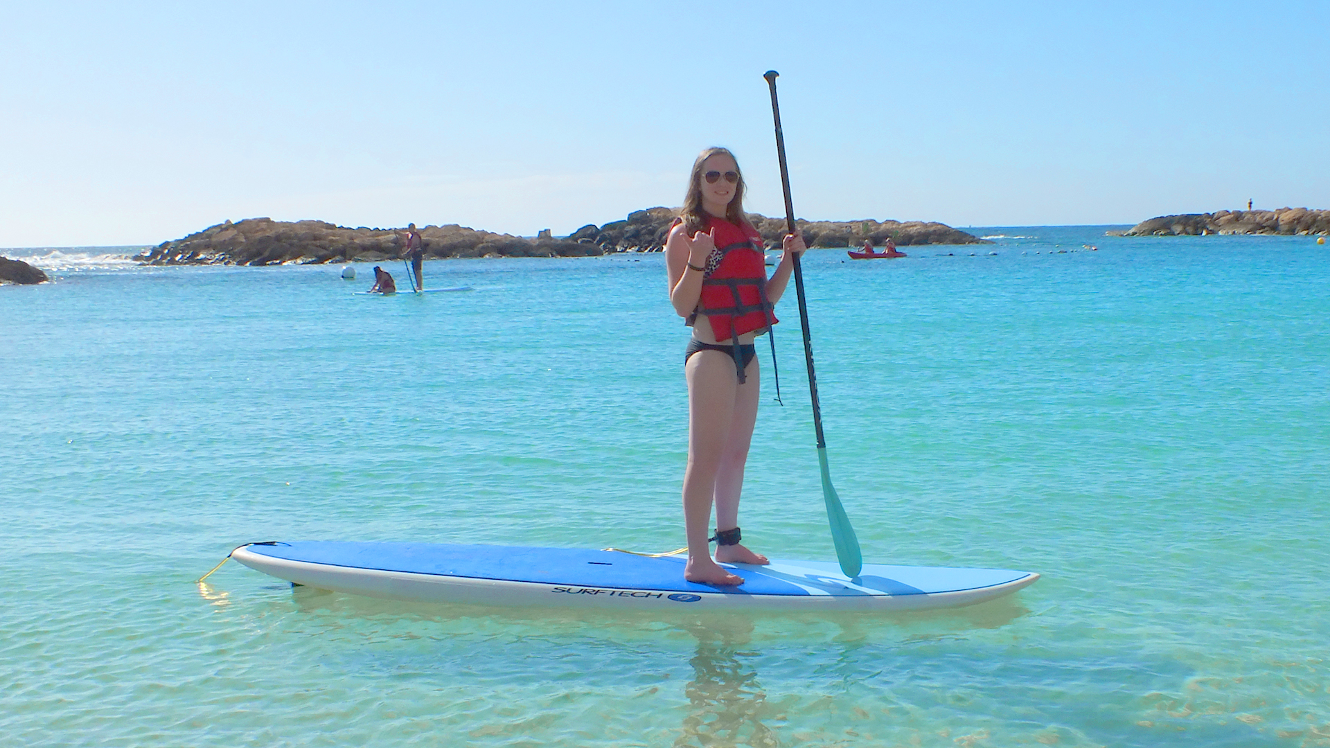 Teen on paddleboard | Sheknows.com