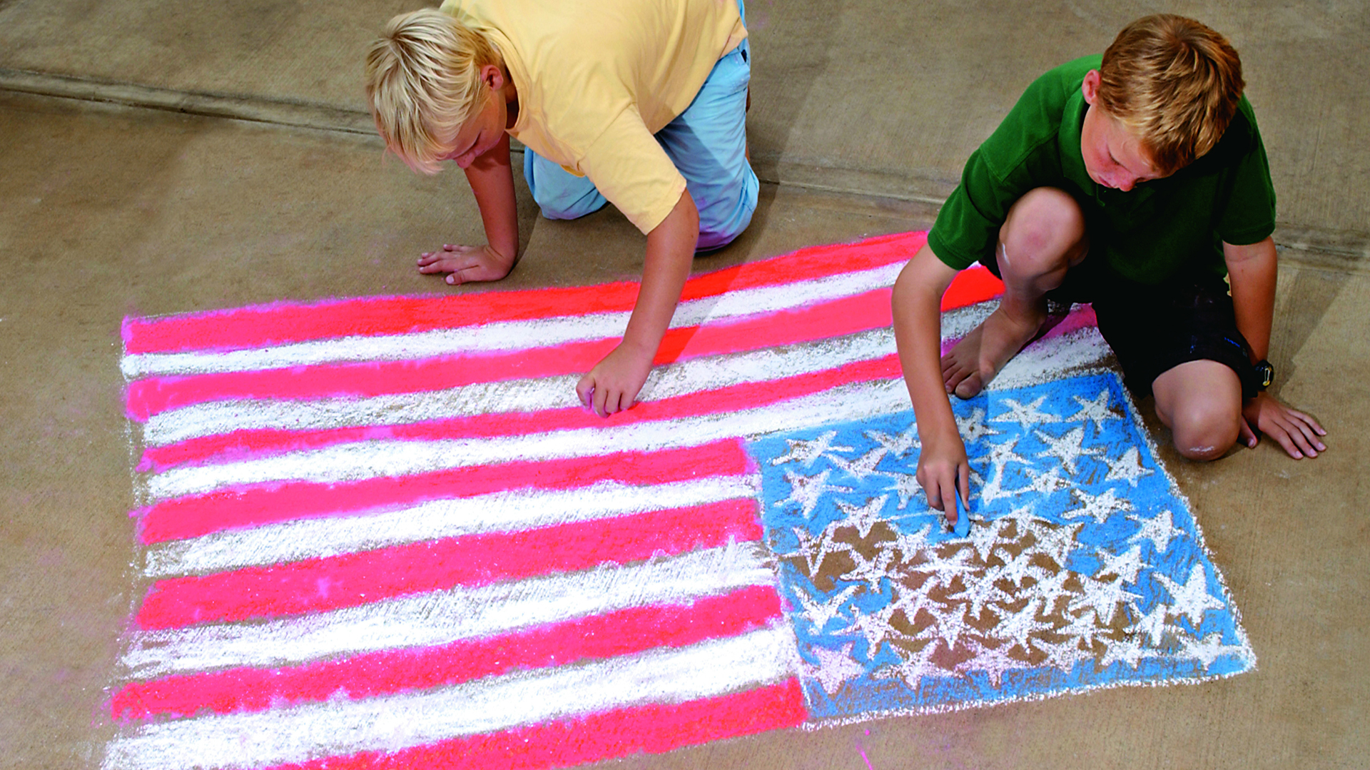 Boys drawing American flag with chalk | Sheknows.com