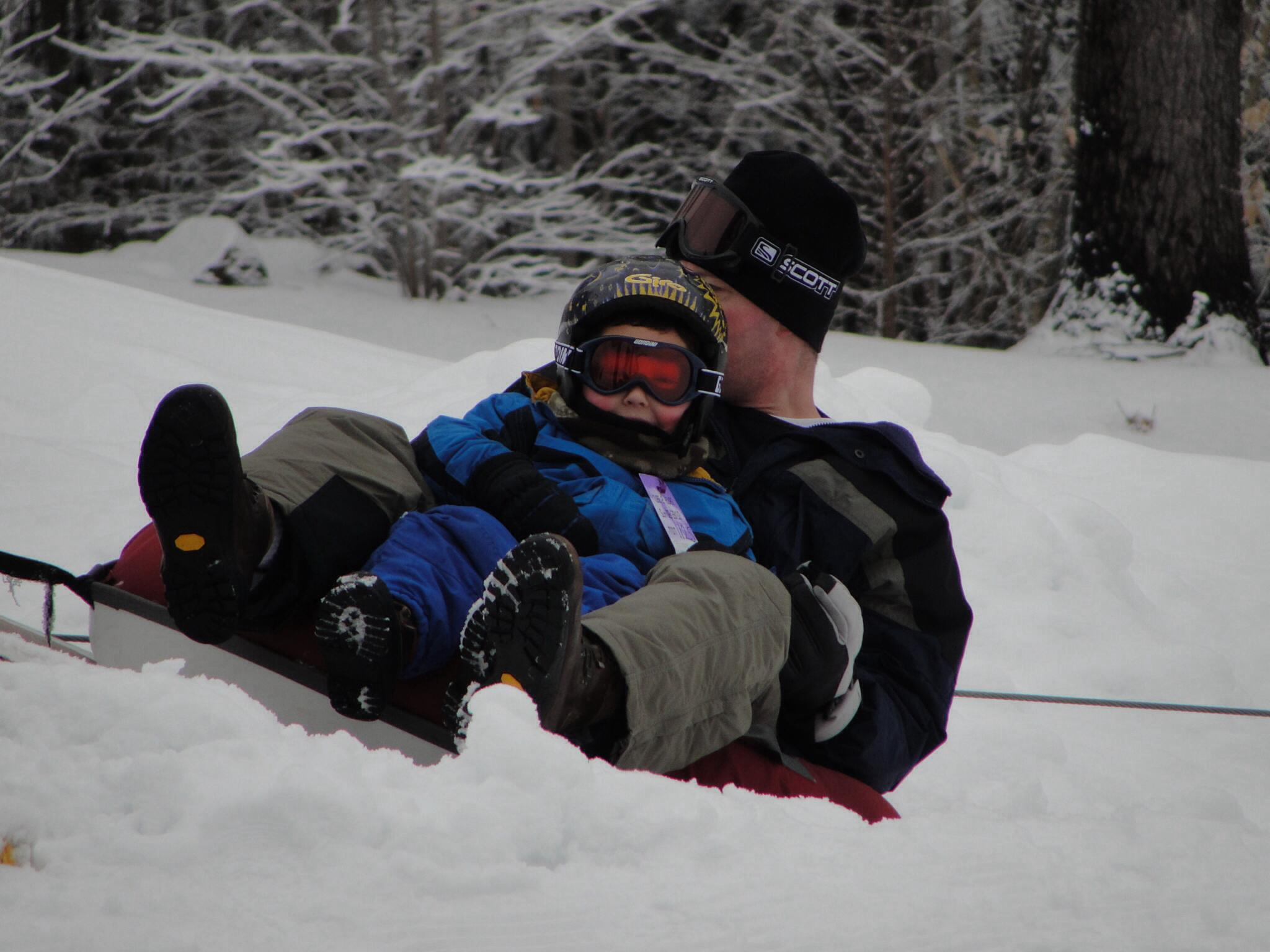 Dads take you down the big sled hill | Sheknows.com